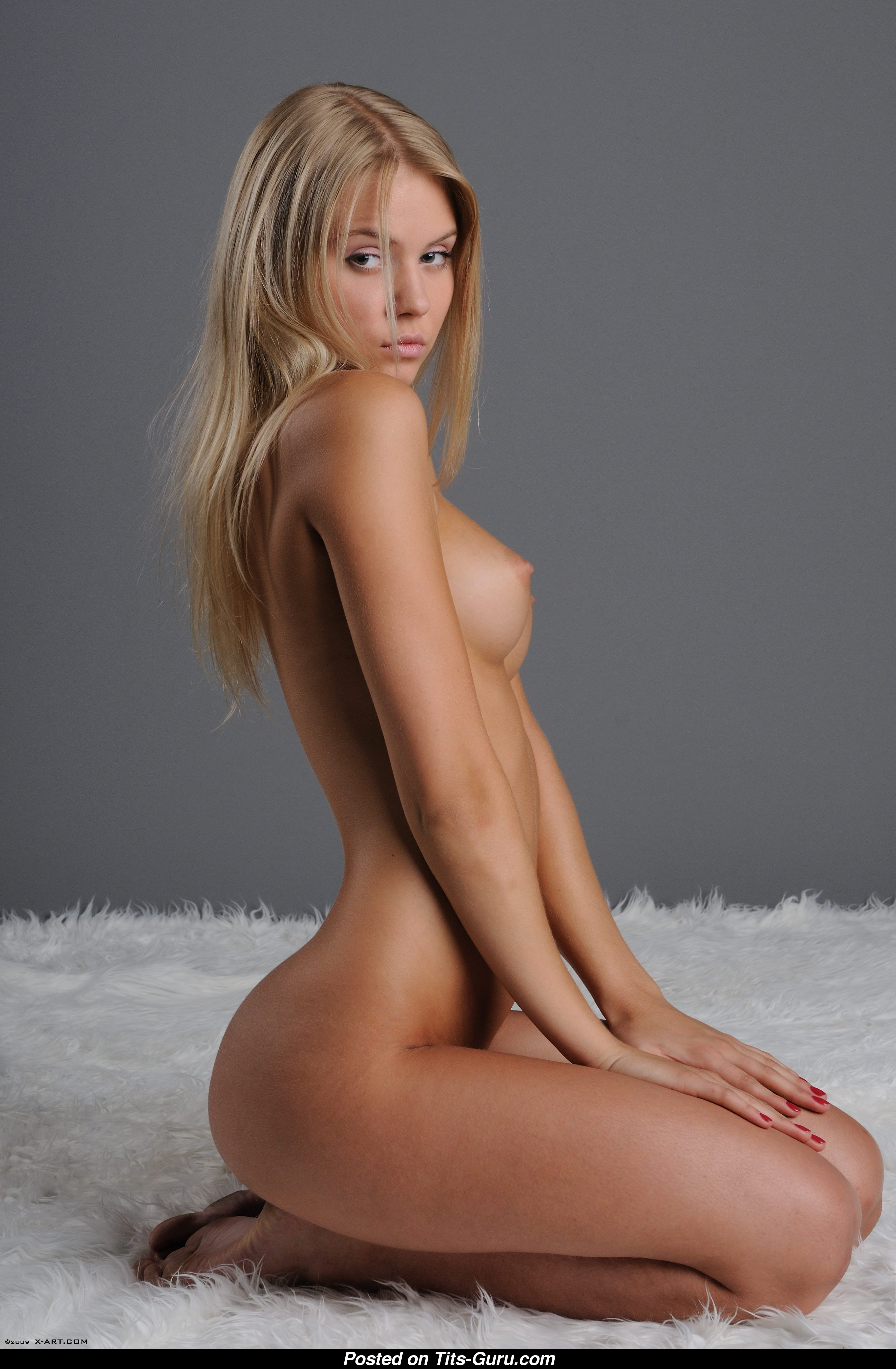 Beautiful naked blonde girl on bed