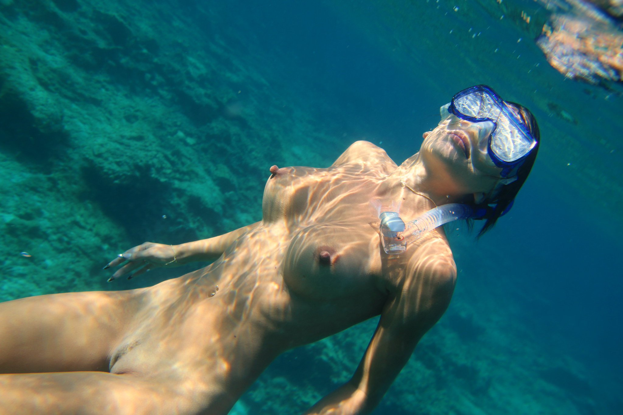Nude girls underwater