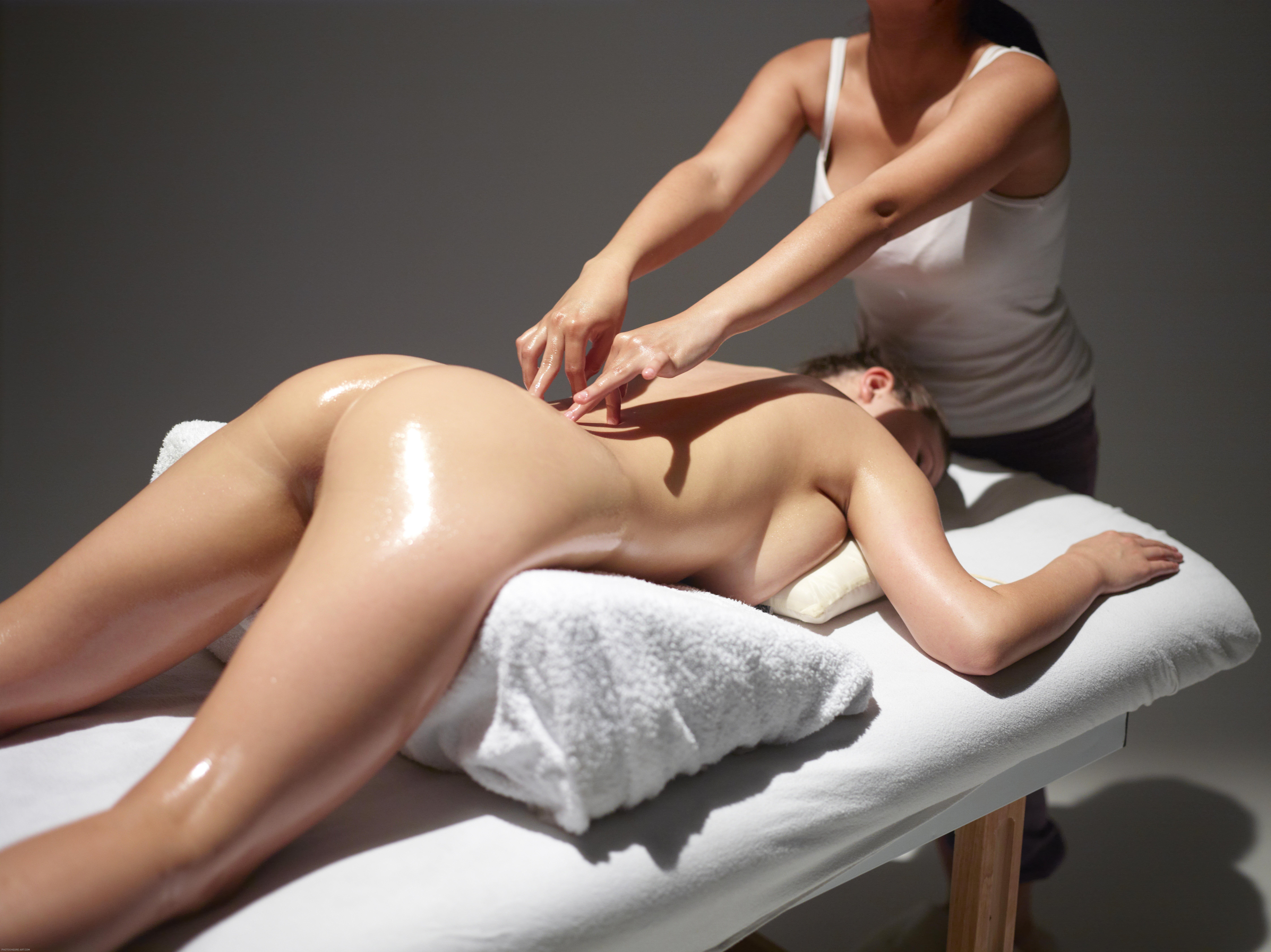 Massage technique taught on a topless goddess