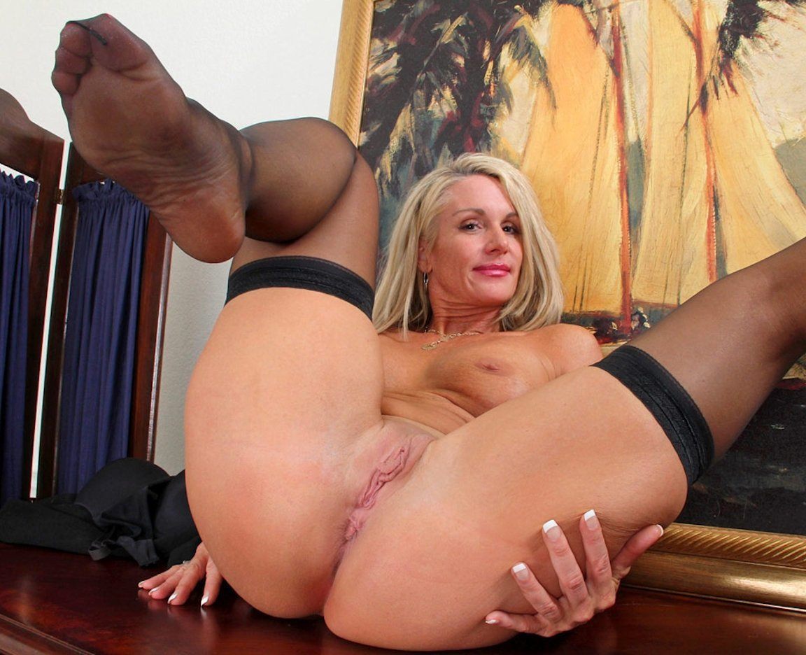 Cute Blonde Milf With Sexy Curves Strips Erotically